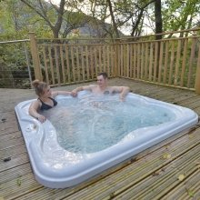 Relax in a hot tub in the woods at RiverBeds